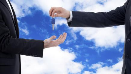 Stock photo of car key being handed over