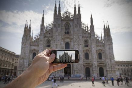 Stock pic of person taking camera phone pic of cathedral