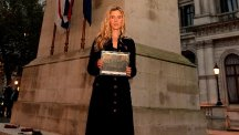 Singer Joss Stone holds a photograph of her great-great-grandfather Alfred Stenning, who was killed in the First World War, at the Cenotaph in central London