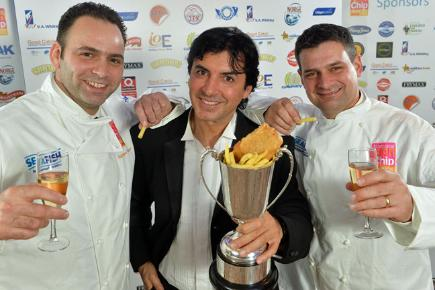 Stuart and Adrian Fusco of Quayside in Whitby, north Yorkshire, with with celebrity chef Jean Christophe Novelli after they were crowned the best UK fish and chip shop in the National Fish and Chip Awards 2014