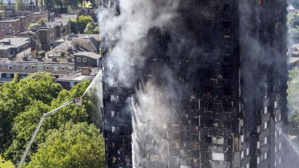 Six dead in London tower block fire, toll expected to rise