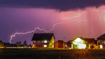 Houses at sunset with lightning
