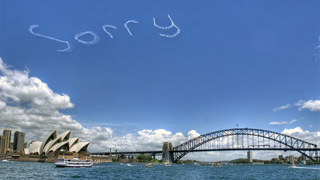 Sky writing over Sydney Harbour on National Sorry Day