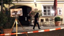 A special police officer examines the scene after an explosion occurred in Ansbach, Germany (AP/Matthias Schrader)