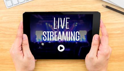 Tablet with words LIVE STREAMING