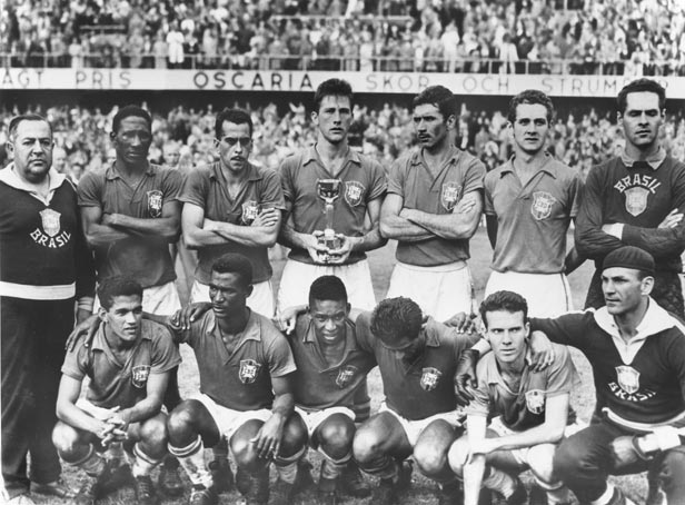 The Brazilian team after the final. Pele is squatting beneath captain Bellini who holds the Jules Rimet Trophy.