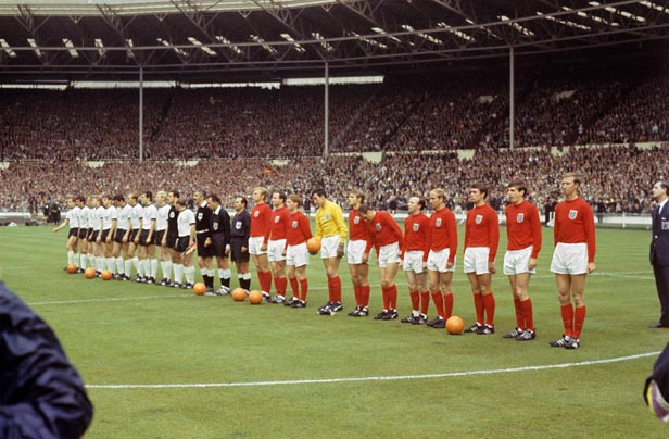 The West Germany and England teams line up at Wembley before the kick-off.