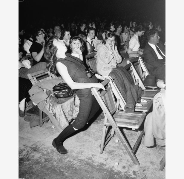 A teenager mimics Elvis's controversial gyrations during a concert in Philadelphia in April 1957.