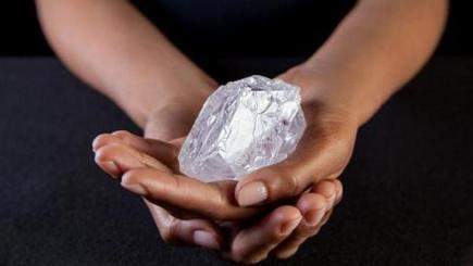 A Sotheby's employee holds the Lesedi la Rona diamond (Donald Bowers/Getty Images for Sotheby's, via AP)