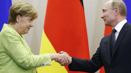 national news tetchy exchange between merkel putin over election interference