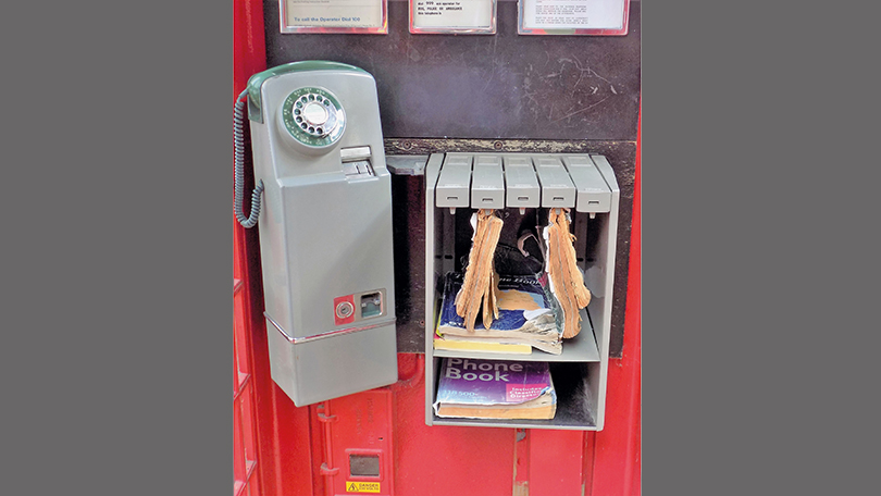 The 705 pay-on-answer telephone and coin box, which replaced the old A/B button coin collecting box.