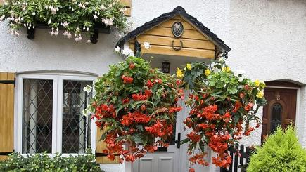 The hanging baskets outside the couple's home