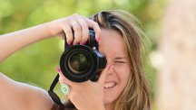 Woman taking photo with DSLR