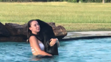 This brave dog tries to save his owner every time she jumps in the pool