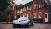 McLaren F1 roadcar in front of mansion house