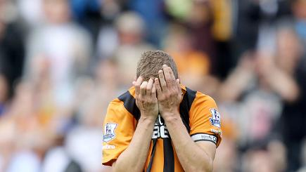 Hull captain holding his head in his hands