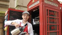 Businessman Jake Hollier on the first day of trading at Jakes' Coffee Box for what is one of the country's smallest coffee shops, based in an iconic British red telephone box in Birmingham