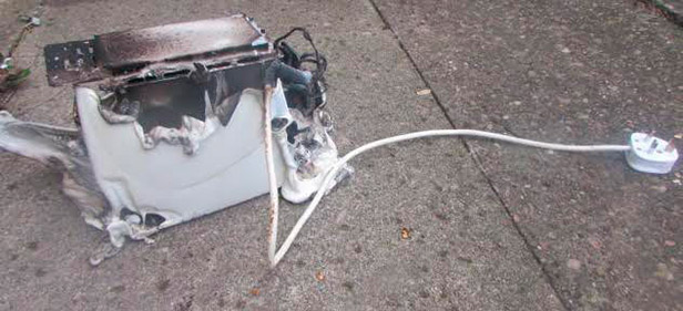 The toaster after the flames had been extinguished.