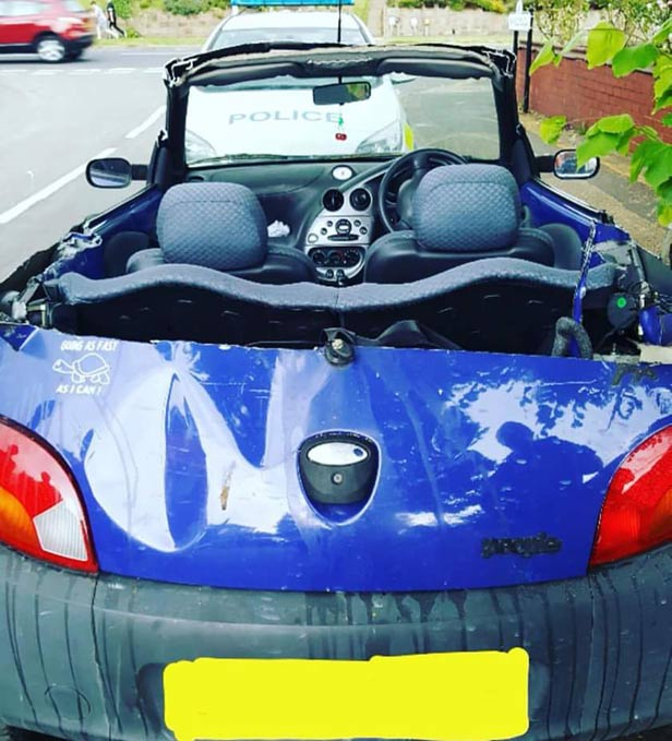 Diy Convertible Motorist Tries To Keep Cool During Heat
