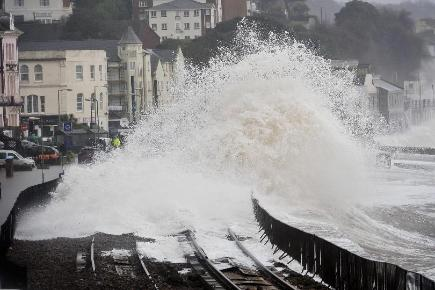 Huge waves break over the railway in Dawlish, where high tides and strong winds have created havoc in the Devonshire town