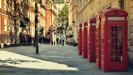 Phone boxes and lamp posts on London street