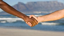 Stock image of people shaking hands.