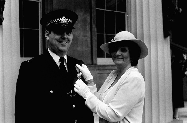 PC Trevor Lock with his wife Doreen after receiving the George Medal at Buckingham Palace.