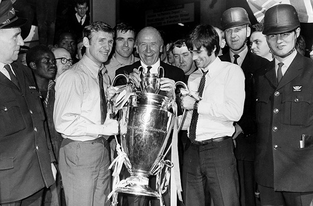 Matt Busby lifts the European Cup