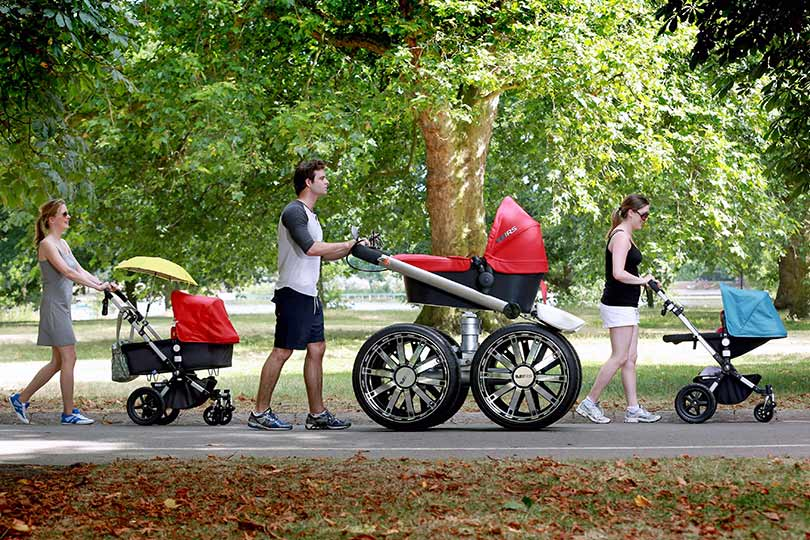 pushing pram in park