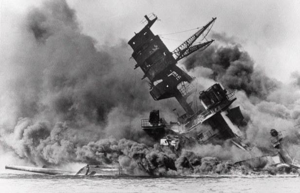 USS Arizona burns in Pearl Harbor
