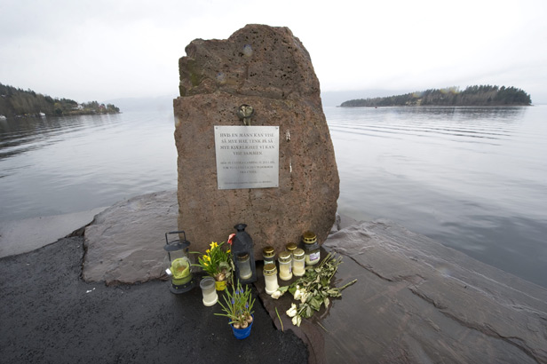 A memorial to those killed in the massacre on the shore overlooking Utoya island (on the right of this image).
