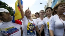 Lilian Tintori, centre, the wife of jailed opposition leader Leopoldo Lopez, joins a protest demanding a recall referendum against President Nicolas Maduro in Caracas (AP)