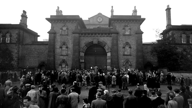 Crowds gather outside Wandsworth Prison awaiting news of the execution of Derek Bentley