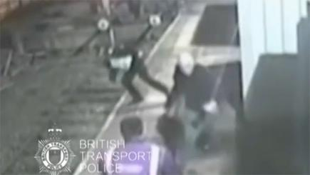 Man pushes police officer onto train tracks