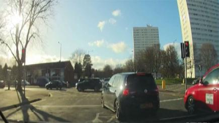 Screengrab of car jumping the queue and traffic lights in Edgbaston, Birmingham