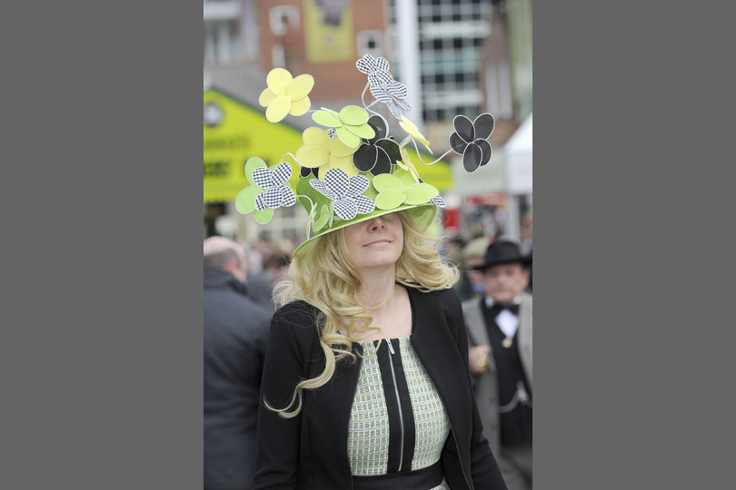 We're not sure how this racegoer is going to see the race, but her hat's pretty.