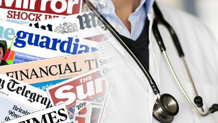 A doctor and the front pages from today's papers