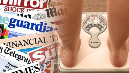 A person using the scales and the front pages from today's papers