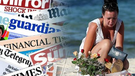 A woman laying a floral tribute and the front pages from today's papers