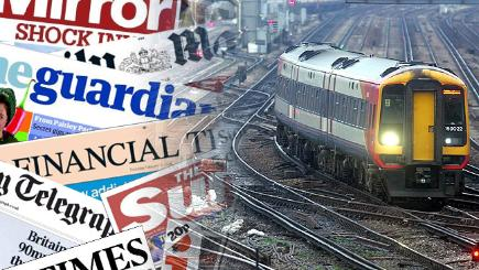 A train and the front pages from today's papers