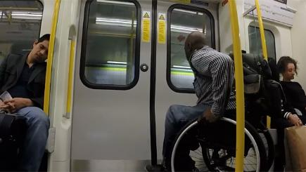 Wheelchair user races Tube train