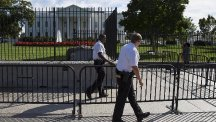 Secret Service police officers patrol outside the White House (AP)