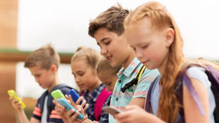 Group of children on smartphones