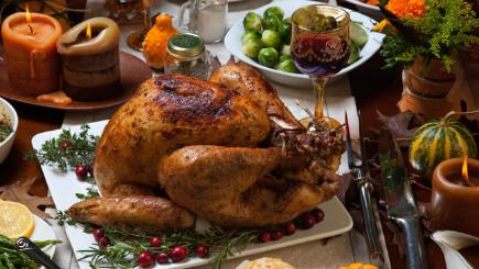 Stock image of a roast turkey and sprouts.