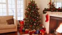 Stock image of a decorated Christmas tree with presents underneath.