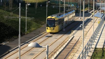 Woman charged with murder of man hit by Manchester tram