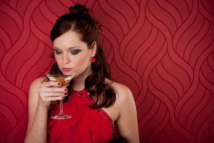 Woman drinking Christmas cocktail