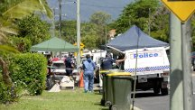 Forensic police outside a house where eight children were found dead in a suburb of Cairns, Queensland (AP)