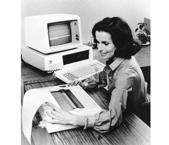 Woman using IBM 5150 Personal Computer