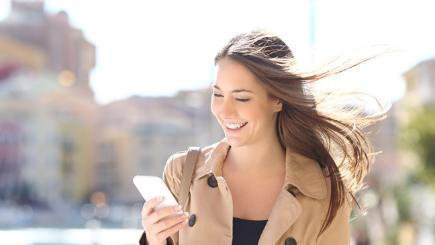 Woman using smartphone smiling